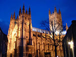 Canterbury cathedral taken at night uplit by powerful spotlights